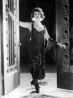 Actress Betty Compson in an evening gown, in a...