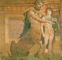 Achille entre les mains du Centaure Chiron lui apprenant la musique sur une cithare 125 x 127 cm. IVe style, 45-79 après J.-C. Naples, Musée Archéologique National inv.9109