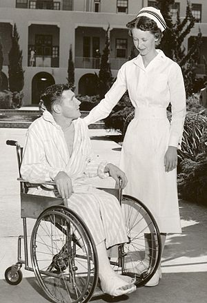Navy nurse with patient, 1940s