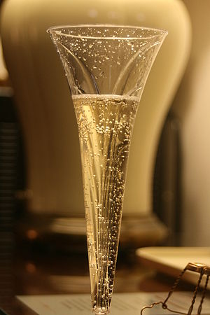 A glass of sparkling champagne in the upward f...