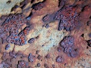 Porção de metal oxidado (corro�do)