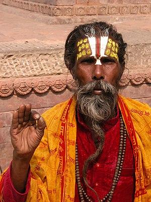 English: Nepali sadhu performing a blessing. F...