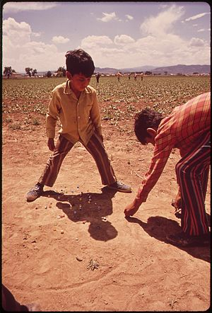 THE CHILDREN OF MIGRANT WORKERS PLAY MARBLES W...