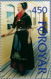 Margrethe II of Denmark in a costume of the Faroese people. Stamp FR 302 of Postverk Føroya, Faroe Islands, issued 14 January 1997.