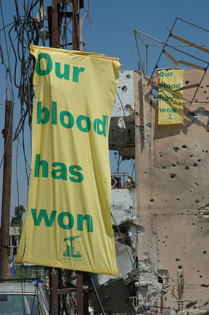 "Banners with the text ""Our blood has won&..."