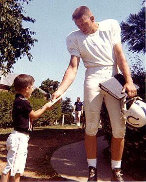 Johnny Unitas signing an autograph at the Balt...