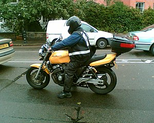 English: Motorcycle courier, London 2007. (Tak...