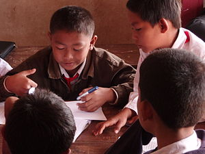 Primary pupils in group work in a small villag...