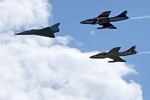 English: Ex-Swiss Air Force historic jets flyi...