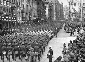 Reichsluftschutzbund personnel march past near...