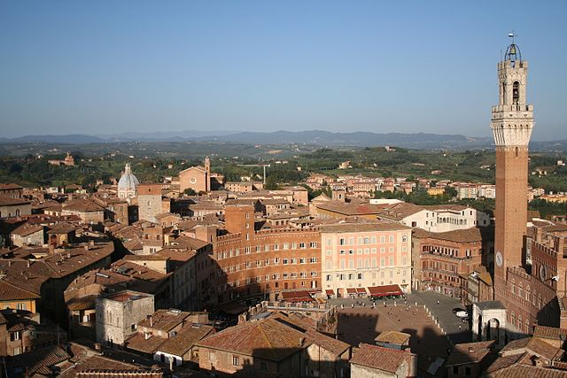 View of downtown Piazza del Campo (Campo Square), which backyard in Mangia Tower (Torre del Mangia) and Santa Maria Church