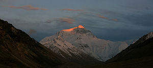 The last rays of sunlight on Mount Everest on ...