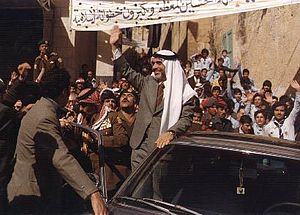 King Hussein waves to a welcoming crowd