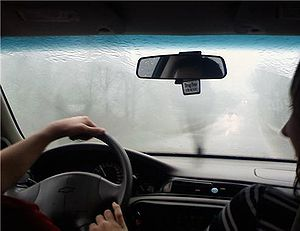 Rain on the windscreen of an automobile with w...