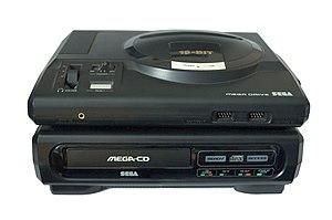 Sega Mega-CD console sitting underneath a Sega...