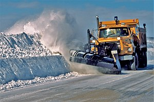 A winter service vehicle clearing roads near T...