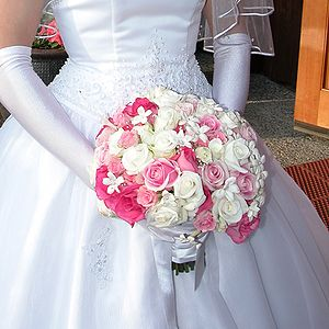 Bridal bouquet of roses and Stephanotis flowers