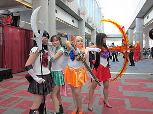 Cosplayers portraying Sailor Mars (red), Sailo...