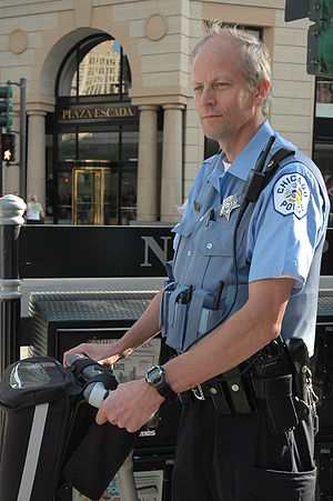 A police officer in Chicago posing on a Segway...