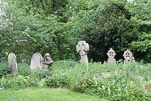 English: Grave stones in the nettles Some of t...