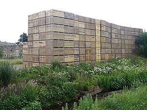 Waiting for the harvest. Stacks of boxes near ...