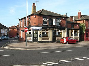 English: Pig 'n whistle Pub at the lower end o...