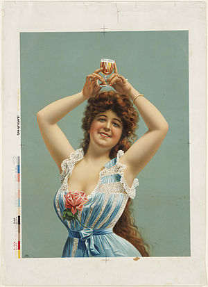 Woman holding glass of beer over her head