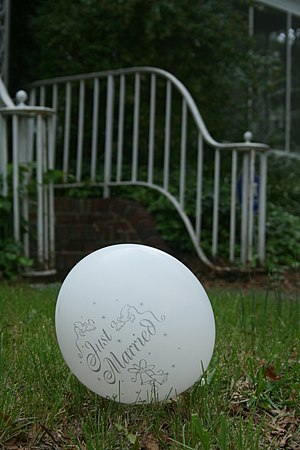 """A discarded """"Just Married"""" balloon r..."""