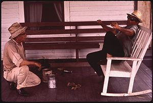 BAYOU GAUCHE FISHERMAN RELAXES WITH NEIGHBOR -...