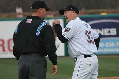 Jeff Isom arguing with an umpire