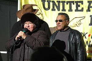 English: Lynne Stewart and Larry Holmes at a M...