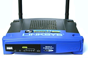 A photo of a version 2 WRT54G Linksys router. ...