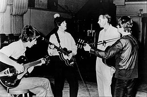 Publicity photo of the Beatles with producer G...