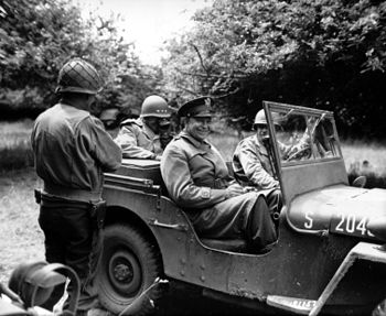 Generals Dwight D. Eisenhower in his jeep in t...