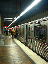 Passengers board a North Hollywood-bound Red L...