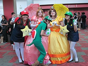 Cosplayers portraying, from left to right: Mar...