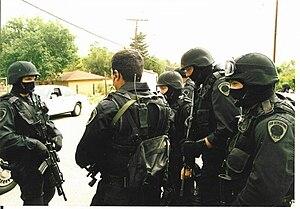 English: San Bernardino police SWAT team confe...