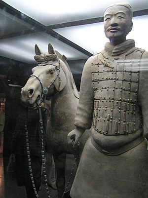 A terracotta soldier with his horse.