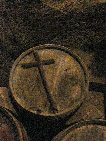 A wine barrel with a cross on it designating t...