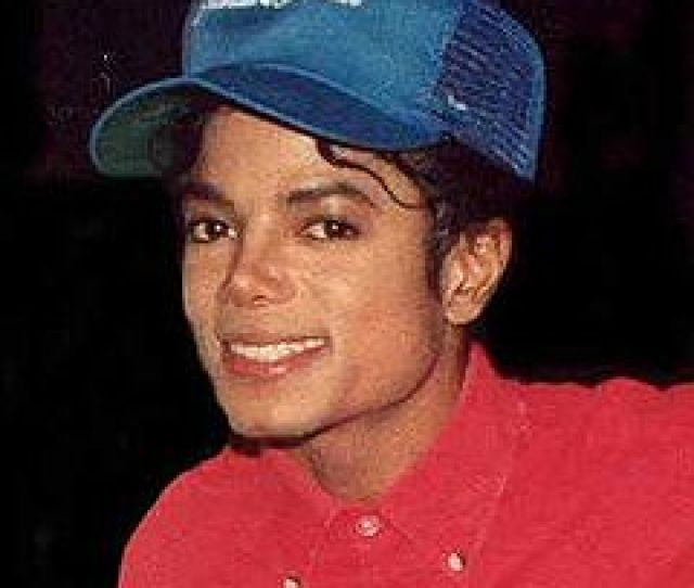A Man In A Red Shirt Smiling Toward The Camera Atop His Head Is A Michael Jackson In 1988