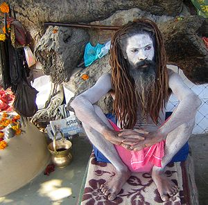 A sadhu relaxing on the bank of river Ganga.