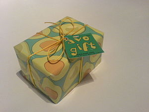 A gift wrapped in yellow and green paper.
