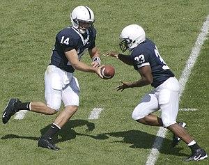 Penn State quarterback #14 Anthony Morelli han...