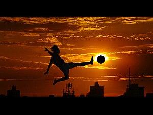 English: Flying soccer kick