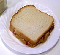 Peanut butter and jelly (jam) sandwich with a ...