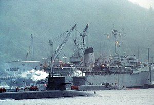Two U.S. Navy submarines come alongside the fl...