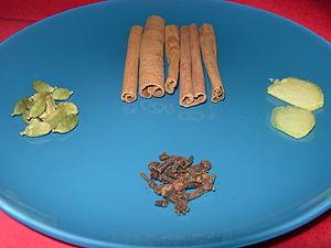 English: Glögg recipe: spices used, clockwise ...