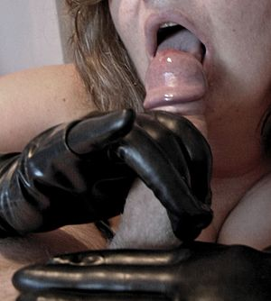 Fellatio with latex gloves - penis outside mouth