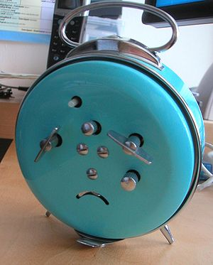 "Chance image: An alarm clock where a ""sad..."