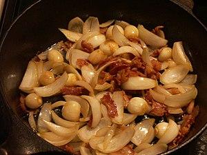 The lardon, onions and garlic being prepared f...